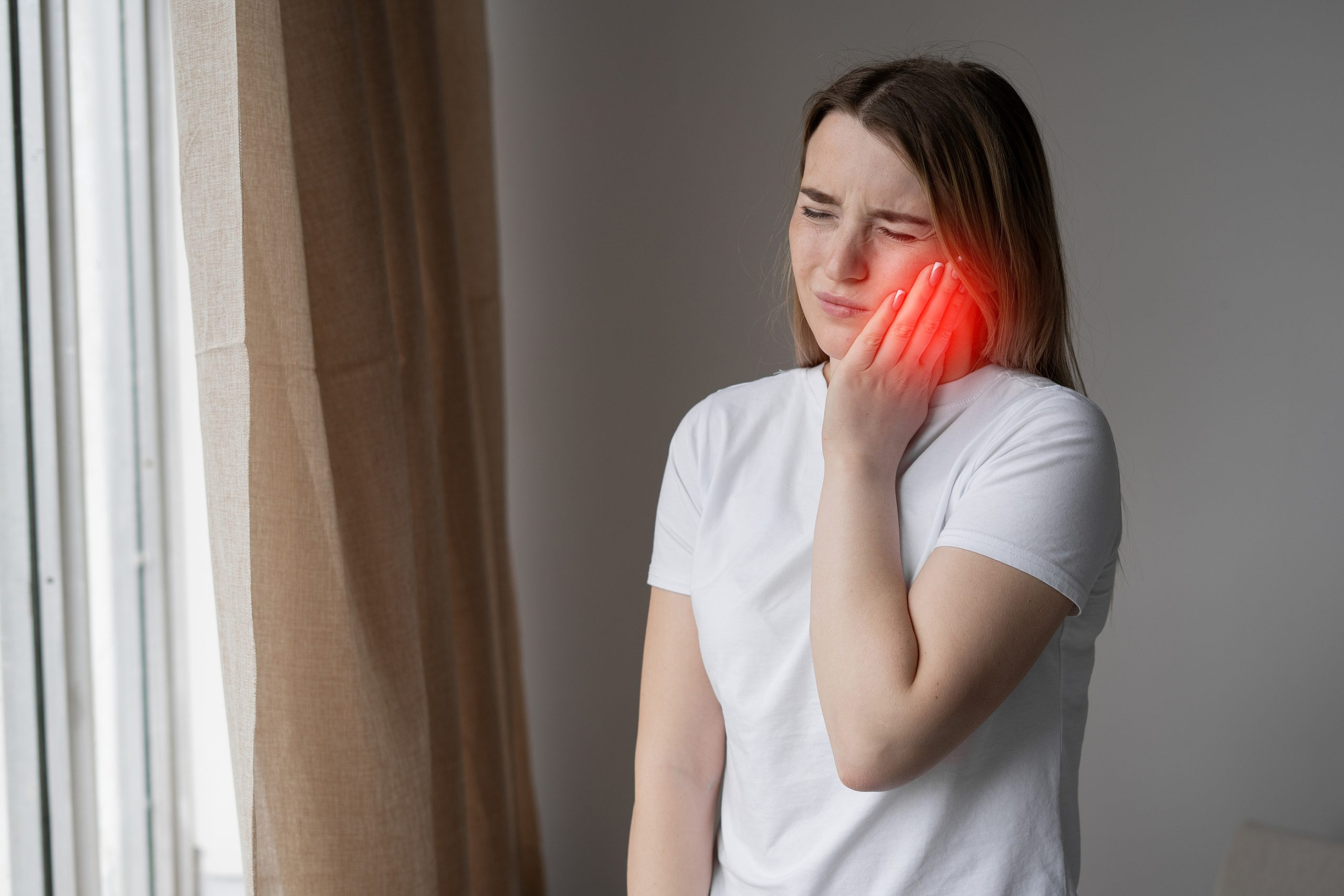 woman with toothache wondering how to get rid of cavities